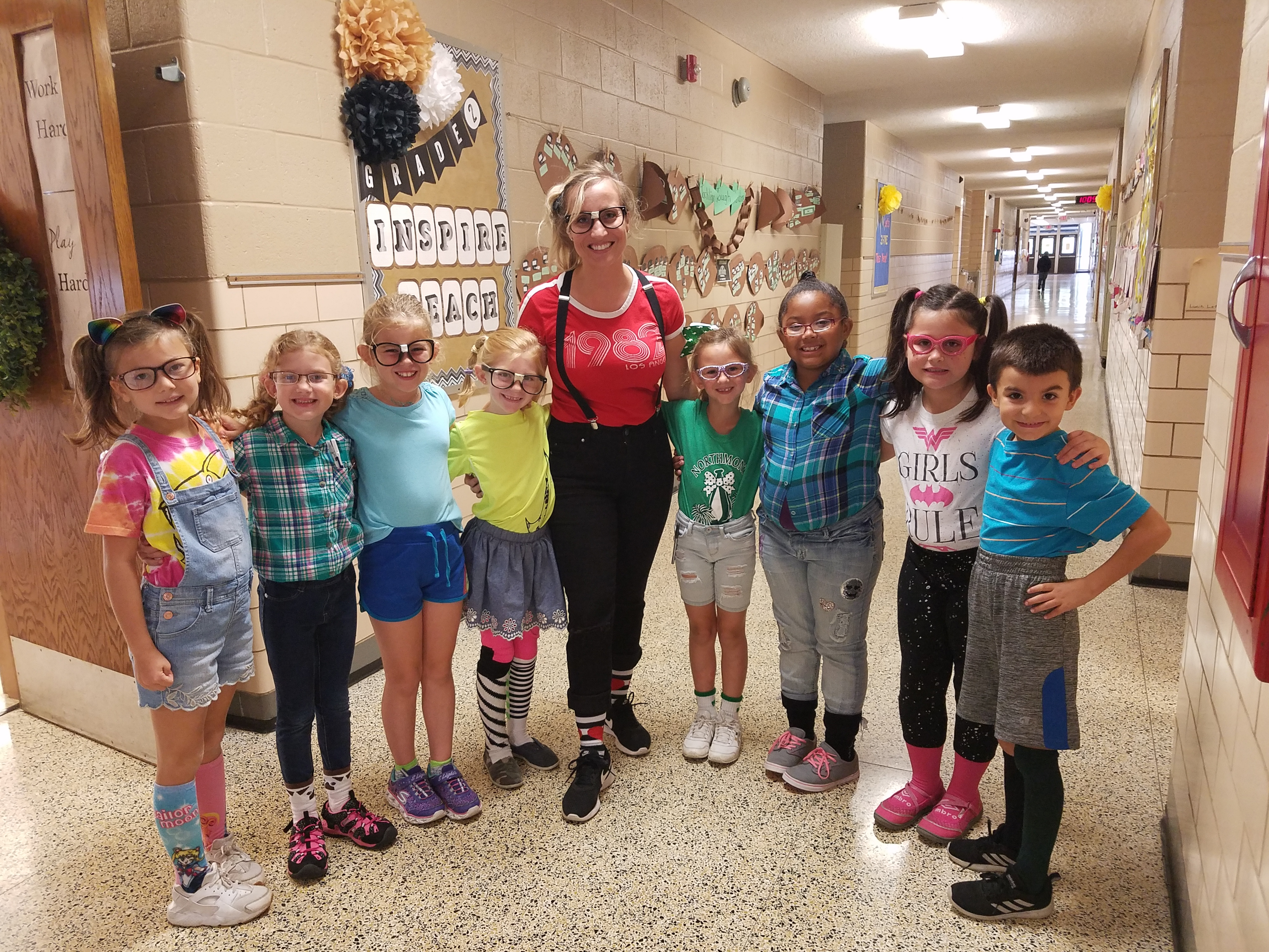 Mrs. Bartolotta and some second graders.