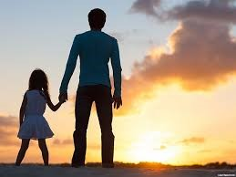 photo of father and daughter holding hands
