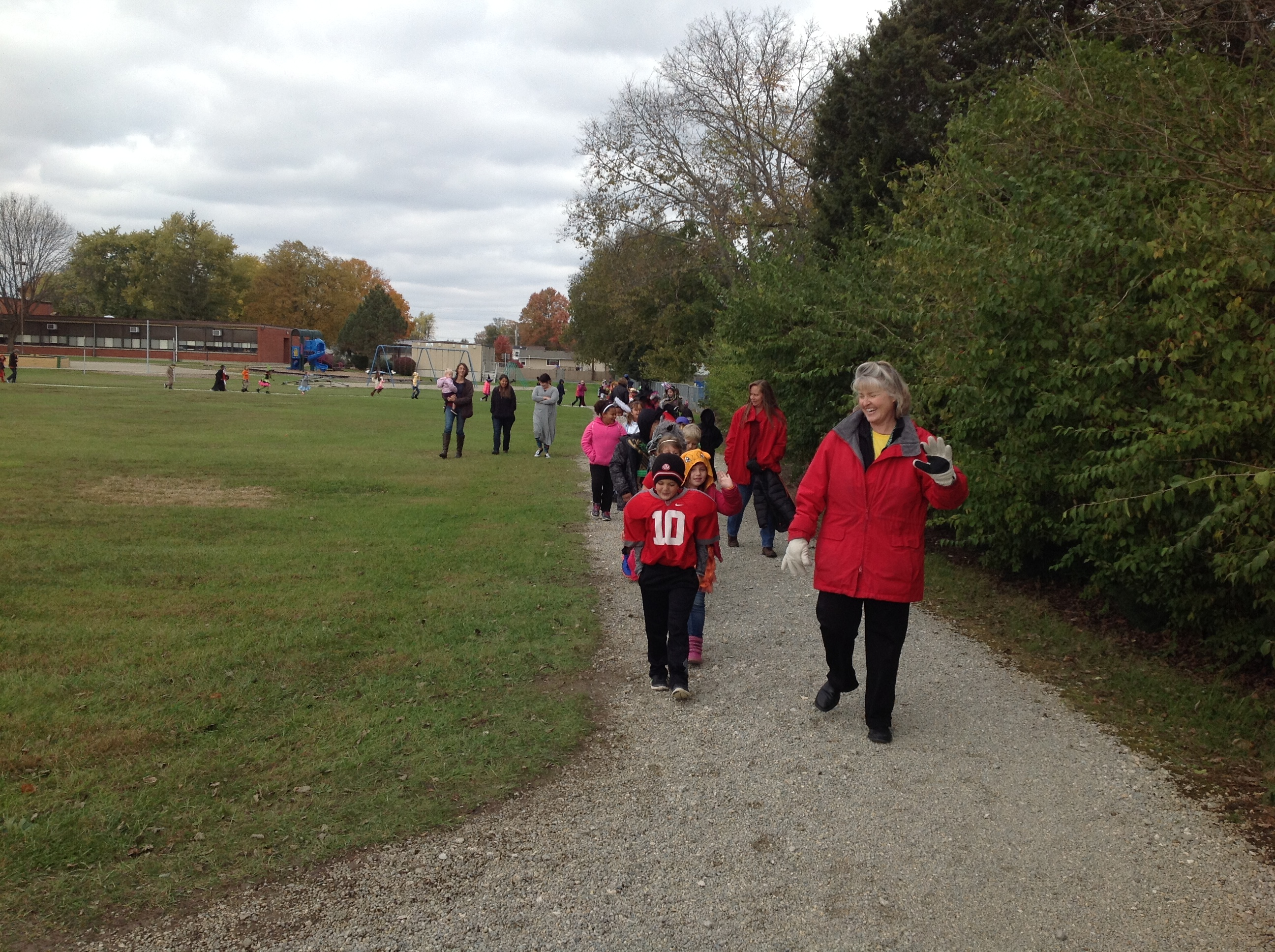 2nd Graders parading around the track
